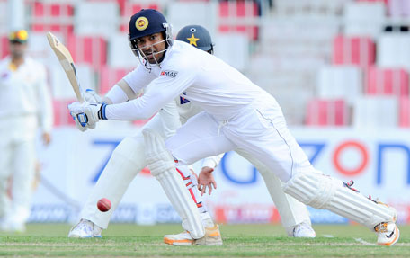 Sri Lankan batsman Kumar Sangakkara plays a shot during the opening day of the third Test match between Pakistan and Sri Lanka at Sharjah Cricket Stadium in Sharjah on January 16, 2014. (AFP)