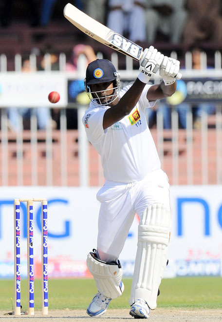 Sri Lanka captain Angelo Mathews drives during his knock on day two of the third Test between  Pakistan and Sri Lanka at Sharjah Cricket Stadium on January 17, 2014. (AFP)