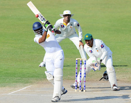 Sri Lanka's Dilruwan Perera hits down the ground on day two of the third Test between  Pakistan and Sri Lanka at Sharjah Cricket Stadium on January 17, 2014. (AFP)