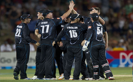 New Zealand celebrate after Virat Kohli of India was caught out during the first international one day cricket match between New Zealand and India in Napier at McLean Park on January 19, 2014. (AFP)