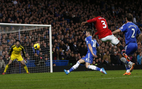 Manchester United's French defender Patrice Evra (2R) takes a shot that hits the side netting during the English Premier League football match between Chelsea and Manchester United at Stamford Bridge in London on January 19, 2014.  (AFP)