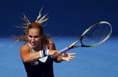 Dominika Cibulkova of Slovakia hits a return to Maria Sharapova of Russia during their women's singles match at the Australian Open 2014 tennis tournament in Melbourne January 20, 2014. (REUTERS)