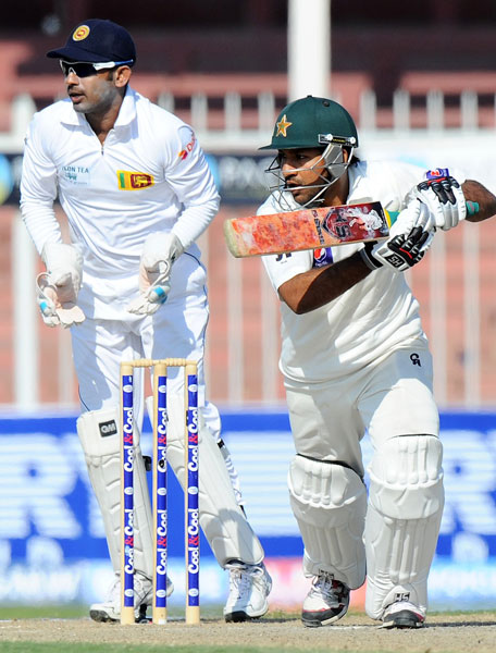 Pakistan's Sarfraz Ahmed plays a shot during his knock of 48 on the fifth day of the third Test between Pakistan and Sri Lanka at Sharjah Cricket Stadium on January 20, 2014. (AFP)