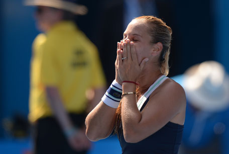Dominika Cibulkova of Slovakia celebrates her victory over Agnieszka Radwanska of Poland in their women's singles semifinal on day 11 of the 2014 Australian Open tennis tournament in Melbourne on January 23, 2014. (AFP)