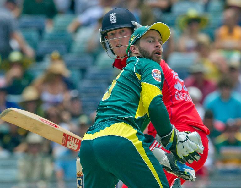 England's batsman Ben Stokes (rear) mistimes a sweep shot as Australia's wicketkeeper Matthew Wade looks on during the fourth one day international cricket match of the series between Australia and England in Perth. (AFP)