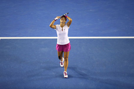 Li Na of China celebrates winning championship point in the women's final against Dominika Cibulkova of Slovakia during day 13 of the 2014 Australian Open at Melbourne Park on January 25, 2014 in Melbourne, Australia. (GETTY)