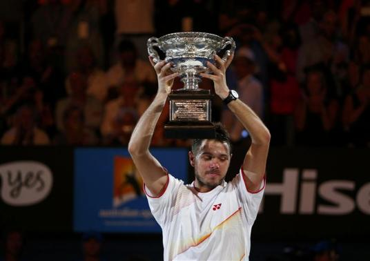 Stanislas Wawrinka of Switzerland poses with the Norman Brookes Challenge Cup after defeating Rafael Nadal of Spain in their men's singles final match at the Australian Open 2014 tennis tournament in Melbourne January 26, 2014. (REUTERS)