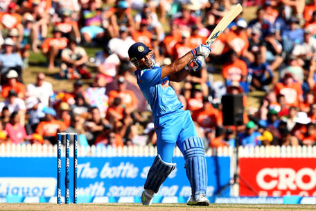 MS Dhoni of India hammers a boundary during game four of the one-day international series between New Zealand and India at Seddon Park on January 28, 2014 in Hamilton, New Zealand. (GETTY)