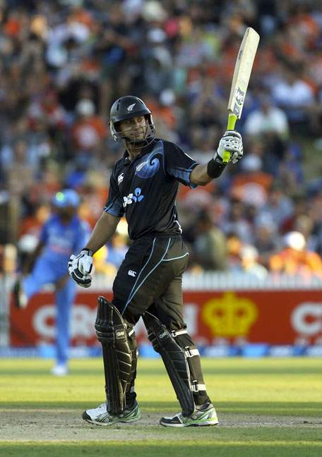 Ross Taylor of New Zealand celebrates his 50 runs during the one-day international cricket match between New Zealand and India at Seddon Park in Hamilton on January 28, 2014. (AFP)