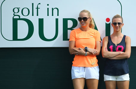Rory McIlroy's companion Caroline Wozniacki (left) of Denmark attend the second round of the 2014 Omega Dubai Desert Classic on January 31, 2014 in Dubai, UAE. (AFP)