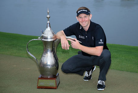 Stephen Gallacher of Scotland with the trophy after the final round where he became the first back to back winner of the Omega Dubai Desert Classic on the Majlis Course at the Emirates Golf Club on February 2, 2014 in Dubai, UAE. (GETTY)