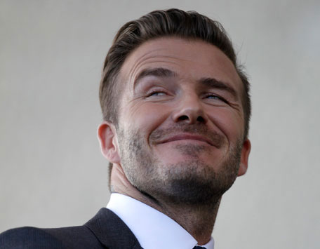 David Beckham smiles as he discusses matters related to the ownership position he has with a proposed Major League Soccer (MLS) expansion team, at a news conference in Miami, Florida February, 5, 2014. (REUTERS)