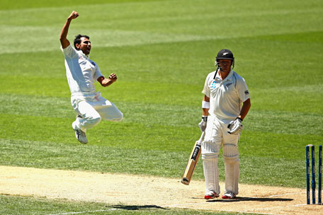 Mohammed Shami (left) of India celebrates bowling Corey Andserson of New Zealand during day three of the first Test between New Zealand and India at Eden Park on February 8, 2014. (GETTY)