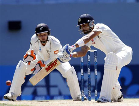 India's Virat Kohli plays a shot watched by New Zealand's BJ Watling during his second innings on day four of the first Test at Eden Park in Auckland, February 9, 2014. (REUTERS)