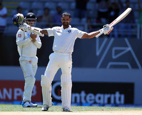 Indian batsman Shikhar Dhawan celebrates his second Test century on the fourth day of the first Test between New Zealand and India at Eden Park in Auckland on February 9, 2014. (GETTY)