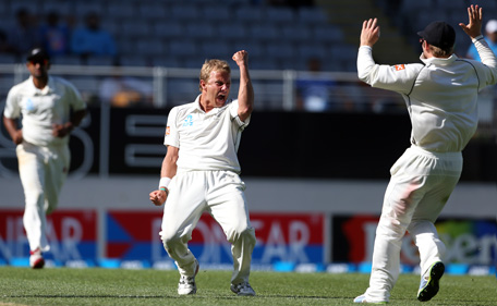 New Zealand's Neil Wagner celebrates the wicket of India's Zaheer Khan during day four of the international cricket Test match between New Zealand and India played at Eden Park in Auckland on February 9, 2014. (AFP)