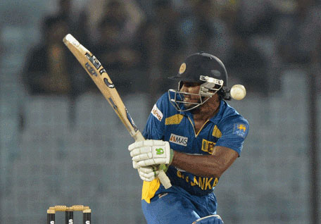 Sri Lankan batsman Kusal Perera plays a shot during the first Twenty20 match between Bangladesh and Sri Lanka at the Zahur Ahmed Chowdhury Stadium in Chittagong on February 12, 2014. (AFP)