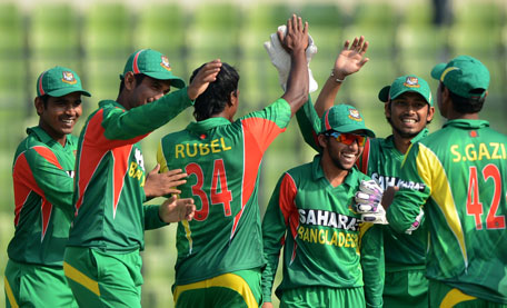 Bangladeshi cricketers celebrate after the dismissal of a Sri Lankan batsman Tillakaratne Dilshan during the first one-day international between Bangladesh and Sri Lanka at the Sher-e-Bangla National Cricket Stadium in Dhaka on February 17, 2014. (AFP)