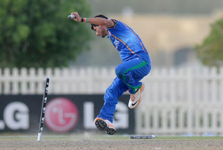 Afghanistan bowler celebrates taking a wicket in the ICC Under 19 Cricket World Cup match against Australia. (IDI/GETTY)