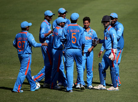 Kuldeep Yadav of India celebrates with teammates during the ICC U19 Cricket World Cup 2014 match between India and Scotland at the Dubai International Stadium on February 17, 2014 in Dubai, UAE. (IDI/GETTY)