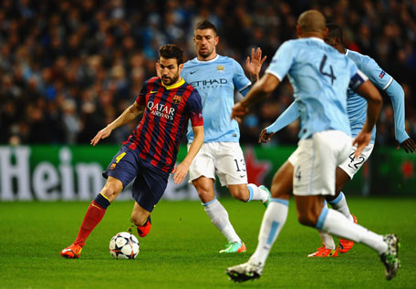 Cesc Fabregas of Barcelona competes with Aleksandar Kolarov of Manchester City during the UEFA Champions League Round of 16 first leg match between Manchester City and Barcelona at the Etihad Stadium on February 18, 2014 in Manchester, England. (GETTY)