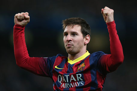 Lionel Messi of Barcelona celebrates scoring the opening goal from a penalty kick during the UEFA Champions League Round of 16 first leg match between Manchester City and Barcelona at the Etihad Stadium on February 18, 2014 in Manchester, England. (GETTY)