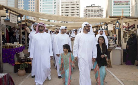 General Sheikh Mohammed bin Zayed Al Nahyan Crown Prince of Abu Dhabi and Deputy Supreme Commander of the UAE Armed Forces, tours the Qasr Al Hosn Festival, on the opening day with Sheikh Ammar bin Humaid Al Nuaimi Crown Prince of Ajman (L), Sheikha Salama bint Mohamed bin Hamed bin Tahnoon Al Nahyan and Sheikha Hessa bint Mohamed bin Hamed bin Tahnoon Al Nahyan. (Ryan Carter/Crown Prince Court - Abu Dhabi )
