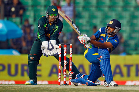 Sri Lanka's Lahiru Thirimanne plays a shot as Pakistan's wicketkeeper Umar Akmal looks on during the opening match of the Asia Cup one-day international cricket tournament in Fatullah, Dhaka, Bangladesh, on Tuesday, Feb. 25, 2014. (AP)