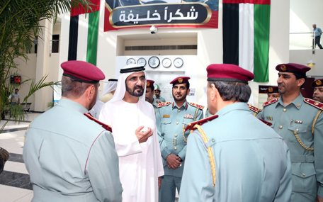 Sheikh Mohammed bin Rashid talks to traffic police men after unveiling a five-star plate at the Fujairah Traffic Centre on Tuesday. (Wam)
