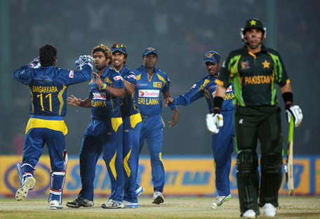 Sri Lankan cricketers congratulate Lasith Malinga (second left) after he dismissed Pakistani cricketer Misbah-ul-Haq during the opening match of the Asia Cup one-day cricket tournament at the Khan Shaheb Osman Ali Stadium in Fatullah, in Dhaka on February 25, 2014. (AFP)