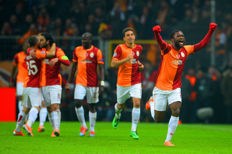 Aurelien Chedjou (right) of Galatasaray celebrates scoring the equaliser during the UEFA Champions League Round of 16 first leg match against Chelsea at Ali Sami Yen Arena on February 26, 2014 in Istanbul, Turkey. (GETTY)