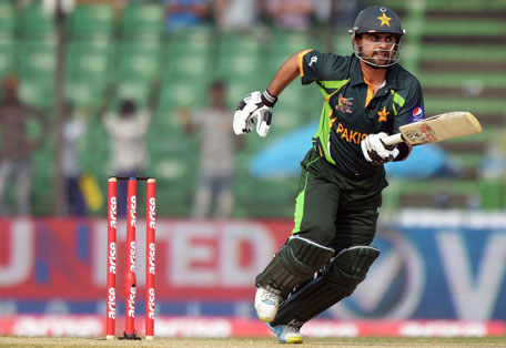 Pakistan batsman Ahmed Shehzad plays a shot during the third match of the Asia Cup one-day cricket tournament against Afghanistan at the Khan Shaheb Osman Ali Stadium in Fatullah, Dhaka on February 27, 2014. (AFP)