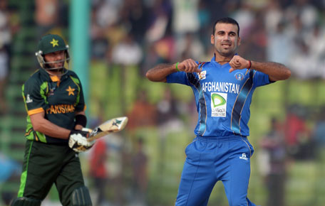 Afghan bowler Dawlat Zadran (right) celebrates after taking the wicket of Pakistani batsman Shahid Afridi during the third match of the Asia Cup one-day cricket tournament at the Khan Shaheb Osman Ali Stadium in Fatullah, Dhaka on February 27, 2014. (AFP)
