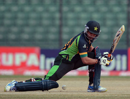 Pakistan batsman Umar Akmal plays a shot during the third match of the Asia Cup one-day cricket tournament between Pakistan and Afghanistan at the Khan Shaheb Osman Ali Stadium in Fatullah, Dhaka, on February 27, 2014. (AFP)