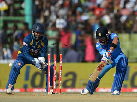 India's Virat Kohli is bowled by Ajantha Mendis of Sri Lanka during Match four of the Asia Cup one-day international cricket tournament between India and Sri Lanka at Fatullah, Dhaka on February 28, 2014. (AFP)