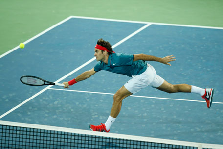 Roger Federer on his way to victory over top seed Novak Djokovic in the Dubai semfinals. (SUPPLIED)