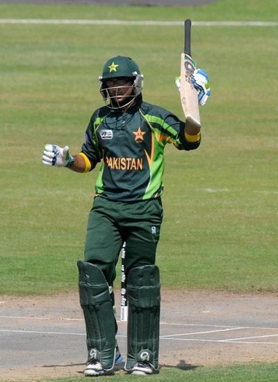 Imam Ul Haq of Pakistan raises his bat after scoring a half century during the ICC U19 CWC super league qualifier 4 match between Pakistan and Sri Lanka played at the Sharjah cricket stadium on February 22, 2014. (IDI/GETTY)