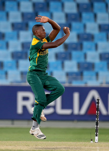 Kagiso Rabada of South Africa bowls during the ICC U19 Cricket World Cup 2014 semifinal against Australia at the Dubai International Stadium on February 26, 2014 in Dubai, UAE. (IDI/GETTY)