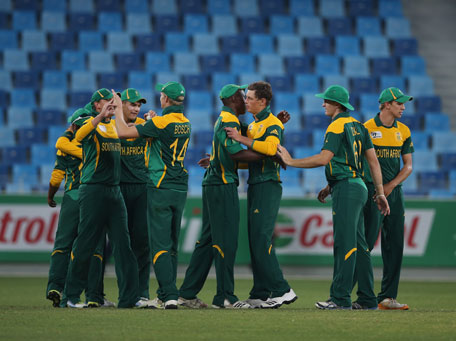 South Africa playeers celebrate after winning the ICC U19 Cricket World Cup 2014 semifinal against Australia at the Dubai International Stadium on February 26, 2014 in Dubai, UAE. (IDI/GETTY)