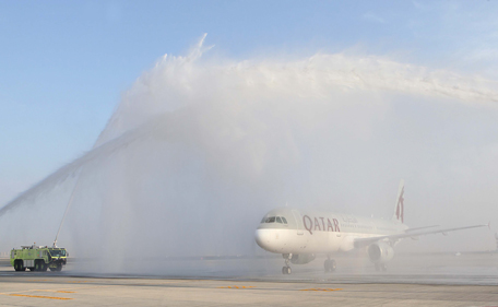Qatar Airways' flight QR-1028 is welcomed with a water salute at DWC's Al Maktoum International Airport, Dubai, on Saturday, March 1, 2014. (Supplied)