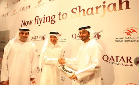 Sheikh Khalid Bin Essam Al Qassimi, Chairman, Department of Civil Aviation, Sharjah, exchanges mementoes with Akbar Al Baker, CEO, Qatar Airways, at a ceremony to welcome the Qatar Airways' flight to Sharjah International Airport. (Supplied)