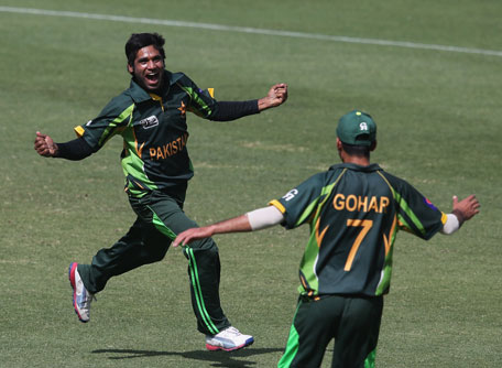 Kamarat Ali of Pakistan celebrates the wicket of Joe Clarke of England during the ICC U19 Cricket World Cup 2014 semifinal at the Dubai International Stadium on February 24, 2014 in Dubai, UAE. (IDI/GETTY)