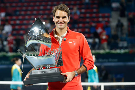 Roger Federer holding the magnificent trophy after winning the Dubai Duty Free Tennis Championships on Saturday. (SUPPLIED)