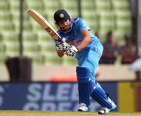 Indian batsman Rohit Sharma plays a shot during the sixth match of the Asia Cup one-day cricket tournament between India and Pakistan at the Sher-e-Bangla National Cricket Stadium in Dhaka on March 2, 2014. (AFP)