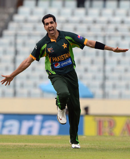 Pakistan bowler Umar Gul reacts after the dismissal of Indian cricket captain Virat Kohli during the sixth match of the Asia Cup one-day cricket tournament at the Sher-e-Bangla National Cricket Stadium in Dhaka on March 2, 2014. (AFP)