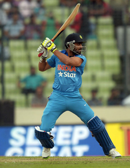 Indian batsman Ravindra Jadeja plays a shot during the sixth match of the Asia Cup one-day cricket tournament between India and Pakistan at the Sher-e-Bangla National Cricket Stadium in Dhaka on March 2, 2014. (AFP)