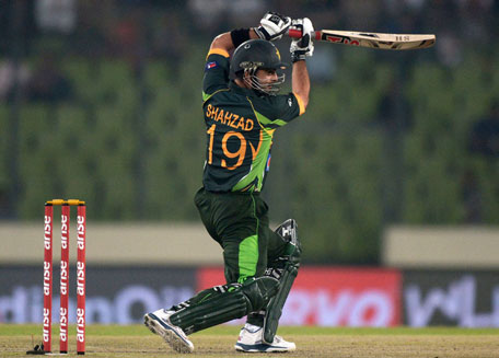 Pakistani batsman Ahmed Shehzad plays a shot during the sixth match of the Asia Cup one-day cricket tournament between India and Pakistan at the Sher-e-Bangla National Cricket Stadium in Dhaka on March 2, 2014. (AFP)