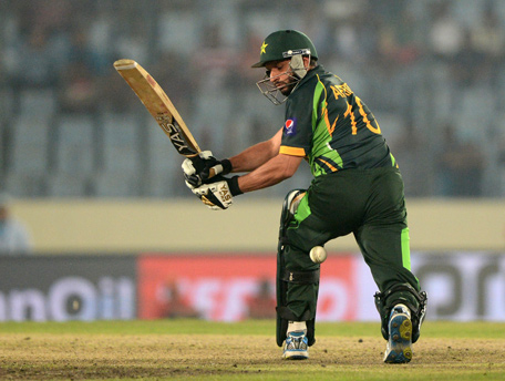 Pakistan batsman Shahid Afridi plays a shot during the sixth match of the Asia Cup one-day cricket tournament between India and Pakistan at the Sher-e-Bangla National Cricket Stadium in Dhaka on March 2, 2014. (AFP)