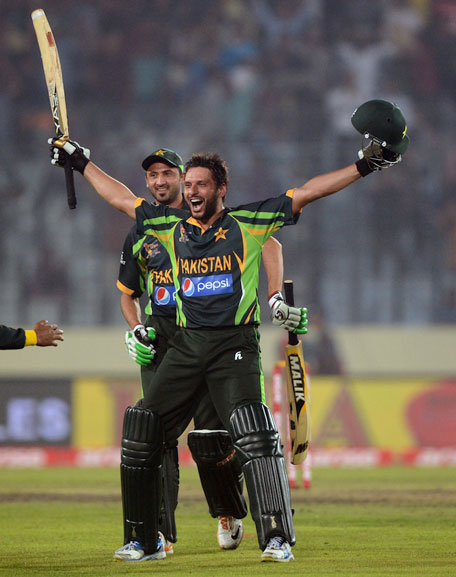 Pakistan batsman Shahid Afridi reacts after winning the sixth match of the Asia Cup one-day cricket tournament between India and Pakistan at the Sher-e-Bangla National Cricket Stadium in Dhaka on March 2, 2014. (AFP)