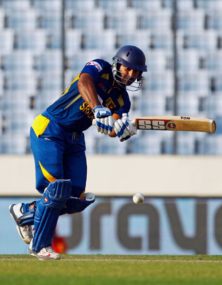Kumar Sangakkara plays a shot during his knock against Afghanistan in the Asia Cup match in Dhaka on Monday. (AP